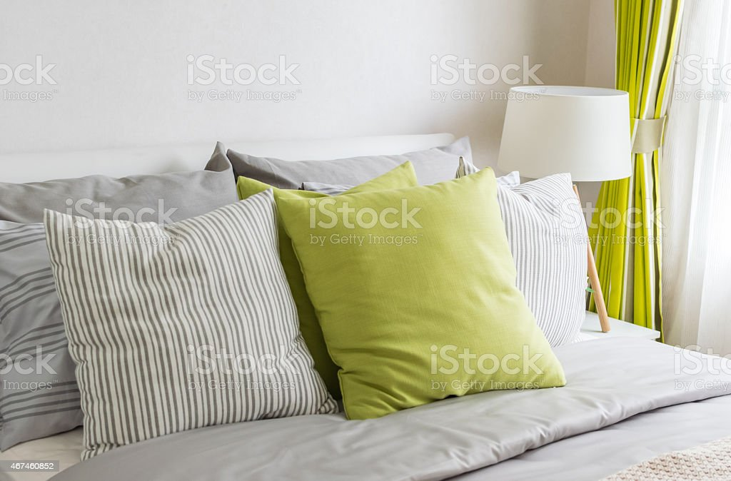 modern bedroom with green pillow on bed stock photo