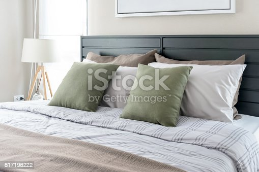 istock modern bedroom with green pillows on bed 817198222