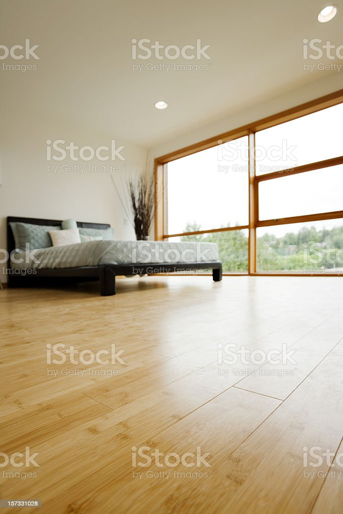 Modern Bedroom with Hardwood Floors stock photo