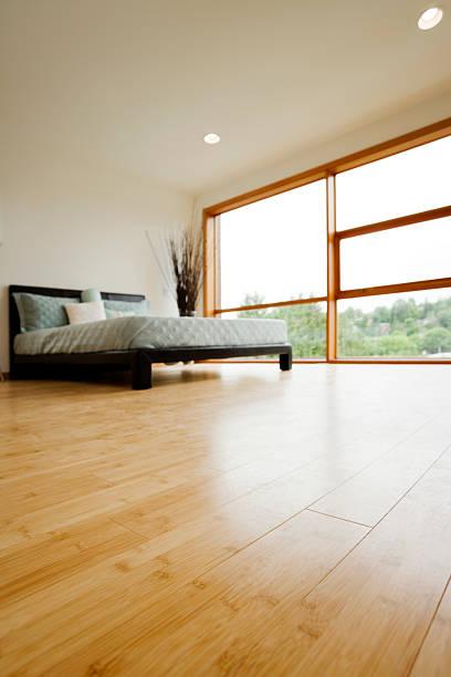 Modern Bedroom with Hardwood Floors stock photo