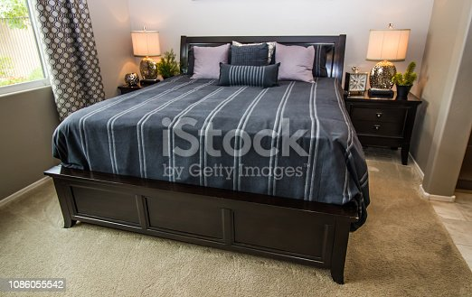 Modern Bedroom With Large Bed, Nightstands And Lamps