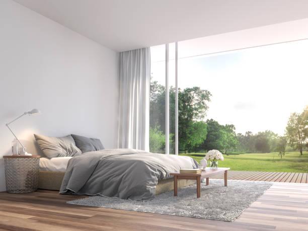 Modernes Schlafzimmer mit großer geöffneter Tür zum Garten 3d render – Foto
