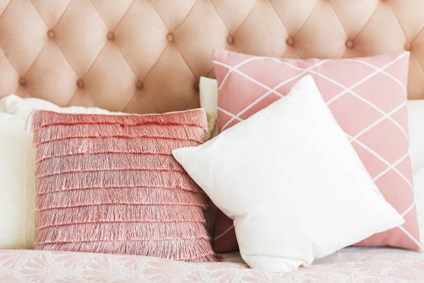Modern bedroom with  pillows Modern bedroom with pink pillows. Close up cushion stock pictures, royalty-free photos & images