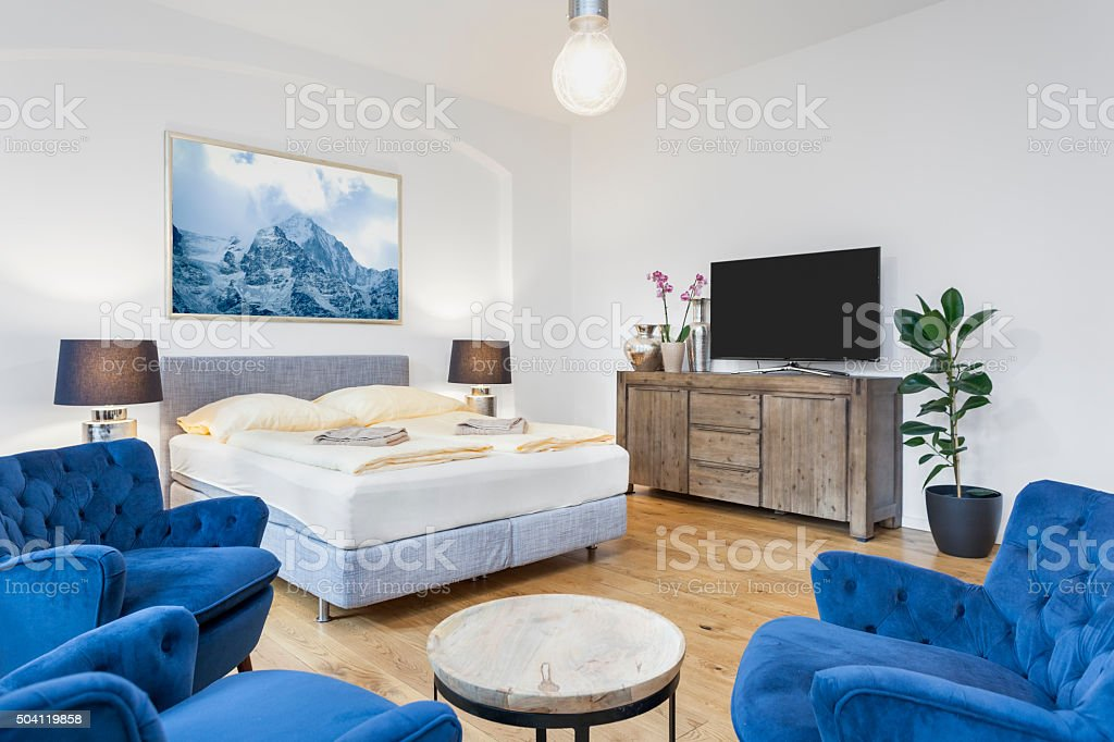 Modern Bedroom with TV and Sitting Area and King Bed stock photo