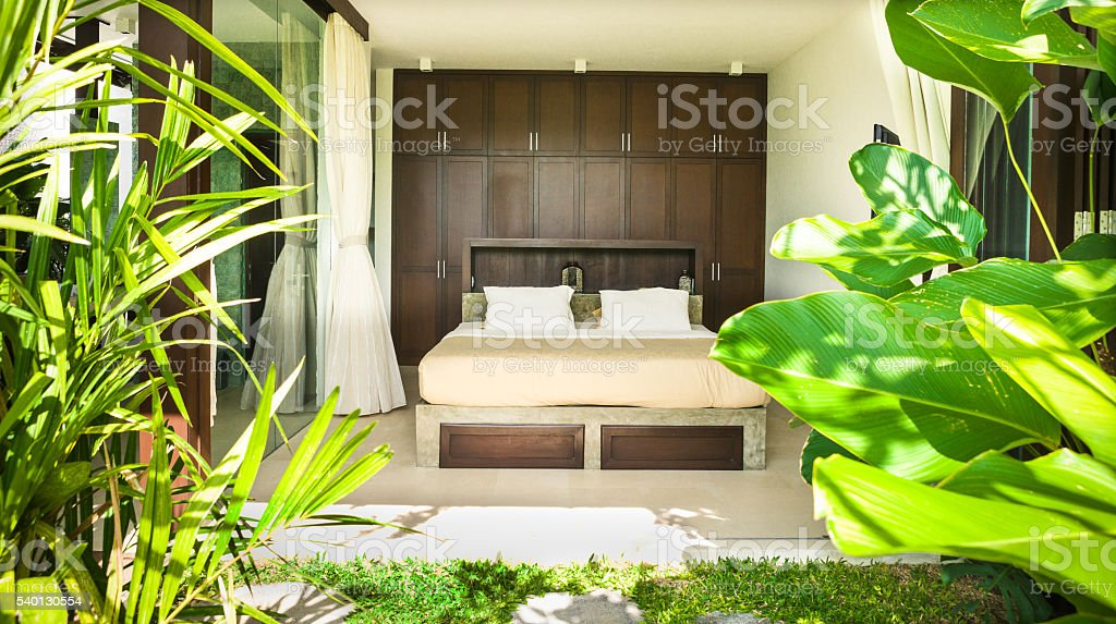 Modern bedroom with two pillows cover with a glass stock photo