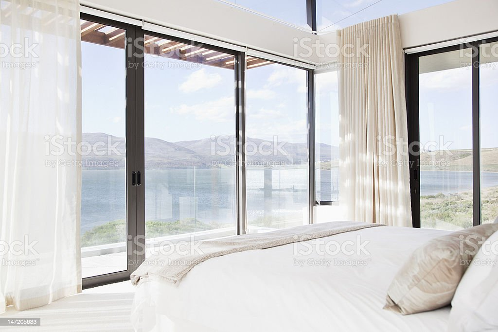 Modern bedroom with view of lake royalty-free stock photo