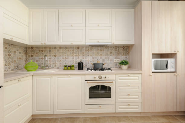 247 Cream Kitchen Cupboards Stock Photos Pictures Royalty Free Images Istock