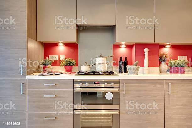 Modern Beige Kitchen With Red Backsplash Stock Photo Download Image Now Istock