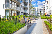 istock Modern benches in front of a new housing estate 1276444130