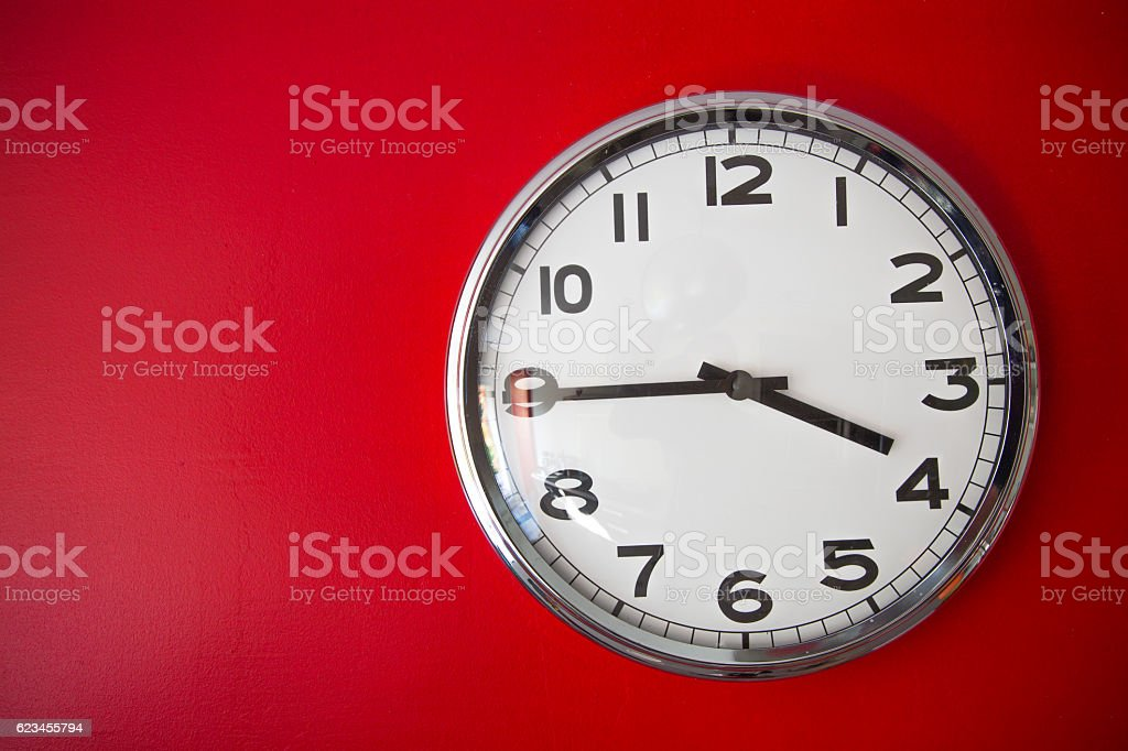 modern big clock on red wall stock photo
