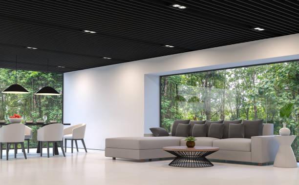 modernen schwarz-weiß wohnzimmer und esszimmer mit wald view 3d rendering-bild - große wohnzimmer stock-fotos und bilder