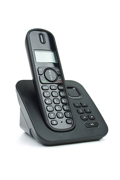 Modern black digital cordless phone with answering machine Modern black digital cordless phone with answering machine isolated on the white background cordless phone stock pictures, royalty-free photos & images