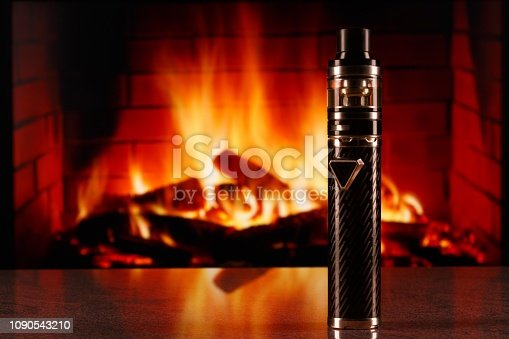 690146632 istock photo modern black electronic cigarette on fireplace background 1090543210
