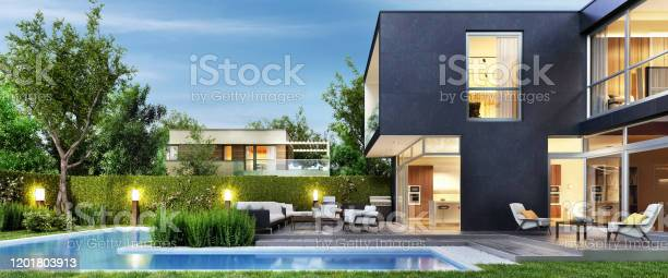 Photo of Modern black house with patio and pool