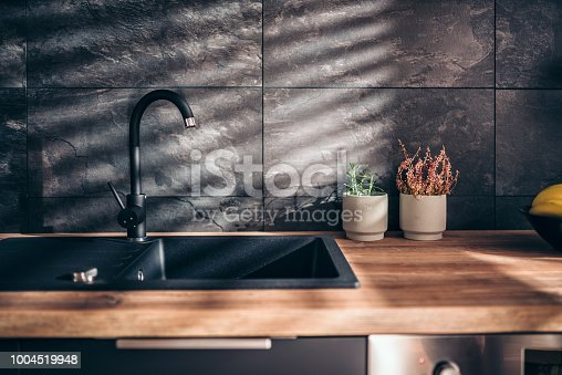Modern kitchen with black sink and fronts