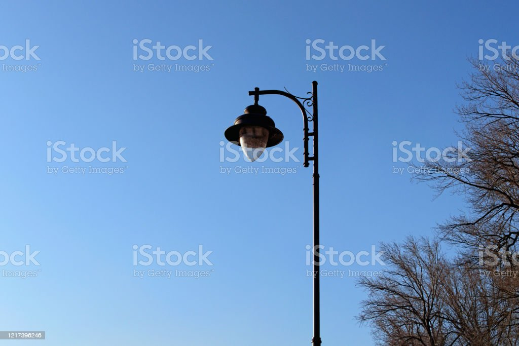 Modern Black Lantern On A High Metal Pole For Street Lighting Against Blue Sky Sunny Morning In The Park Kyiv Ukraine Stock Photo Download Image Now Istock