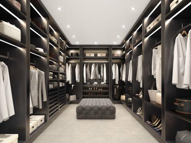 Modern black luxury walk in closet, dressing room, wardrobe stock photo