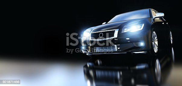 istock Modern black metallic sedan car in spotlight. Banner 921871456