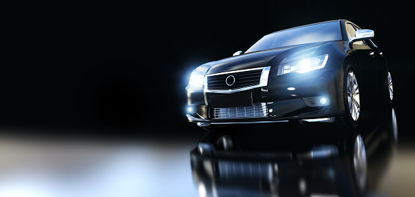 Modern Black Metallic Sedan Car In Spotlight Banner - Fotografie stock e altre immagini di Affari