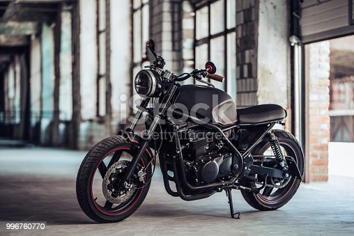 Modern black motorcycle in garage. Cafe racer.