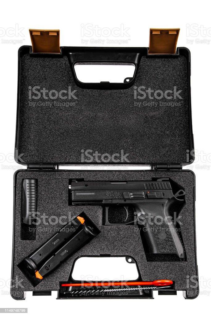 Modern black pistol in plastic case isolated on white background Modern black pistol in plastic case isolated on white background Ammunition Stock Photo