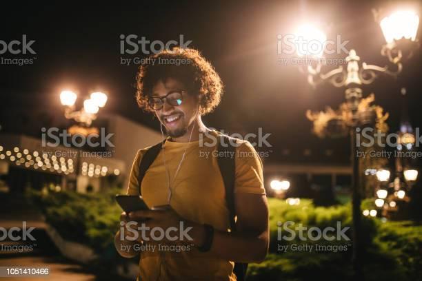 Modern black student texting on his mobile phone and smiling at night picture id1051410466?b=1&k=6&m=1051410466&s=612x612&h=iedie j7qzc 7v 19lxy11qymzn0wjopi1ruhwbt9n8=