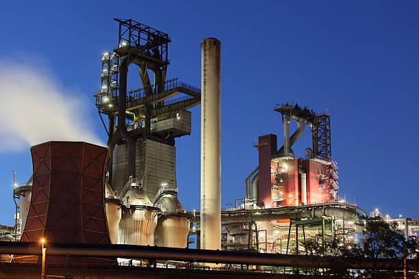 Modern blast furnaces at dusk stock photo