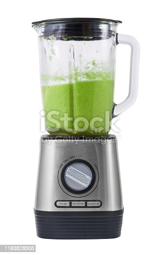 Modern stationary blender with ready green cocktail in a bowl isolated on white background.