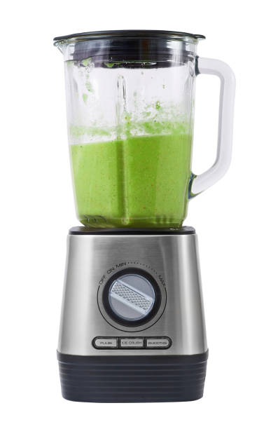Modern blender isolated on white background Modern stationary blender with ready green cocktail in a bowl isolated on white background. blender stock pictures, royalty-free photos & images