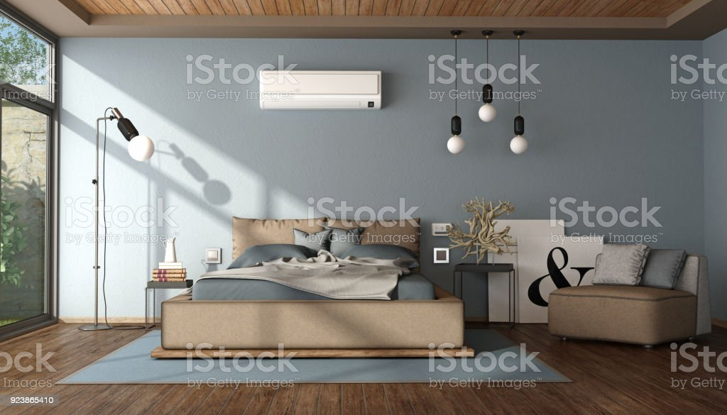 Modern blue and brown master bedroom - foto stock