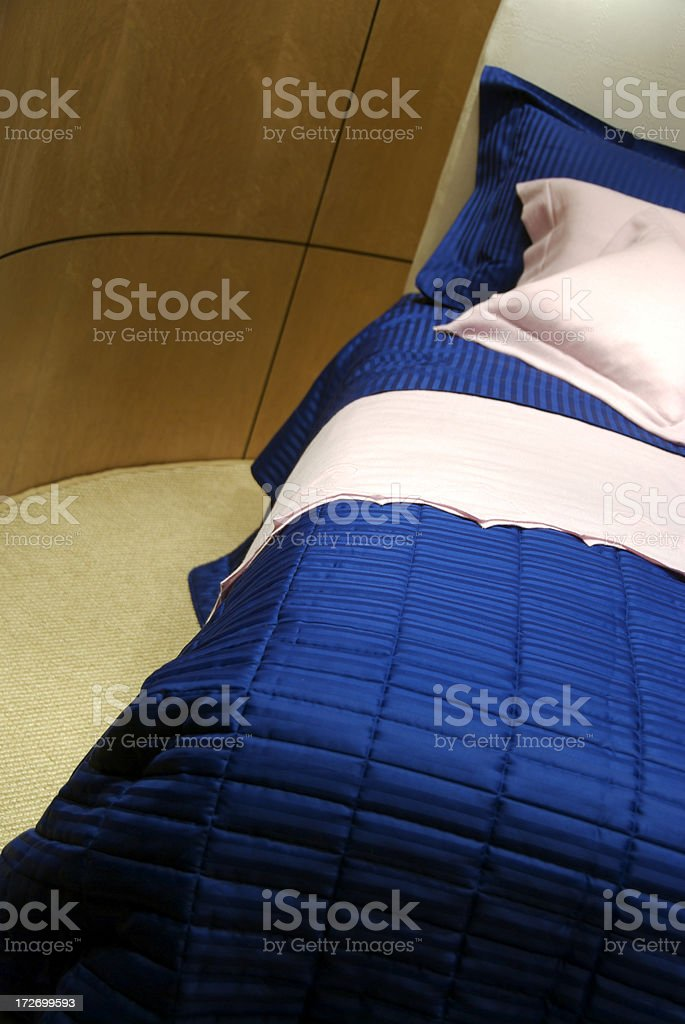 Modern Blue Bed Curved Wall royalty-free stock photo