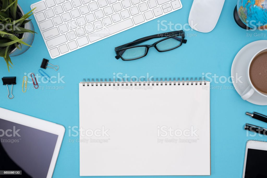 Modern blue office desk table with computer and other supply stock photo