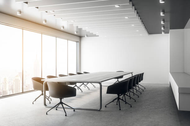 Modern board room Modern board room interior with city reflections and copy space. 3D Rendering empty desk stock pictures, royalty-free photos & images