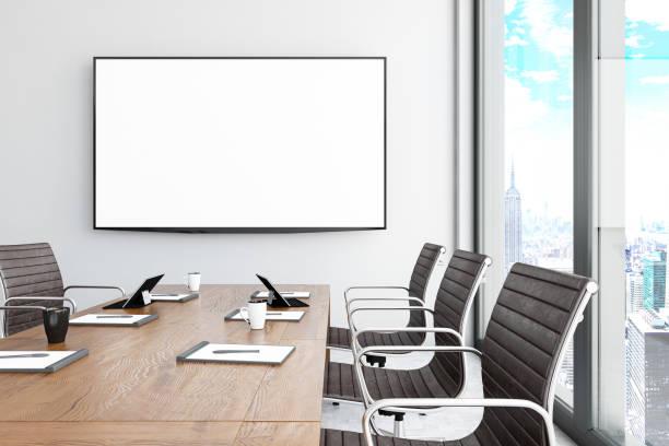 Modern Board Room with Blank TV Screen stock photo