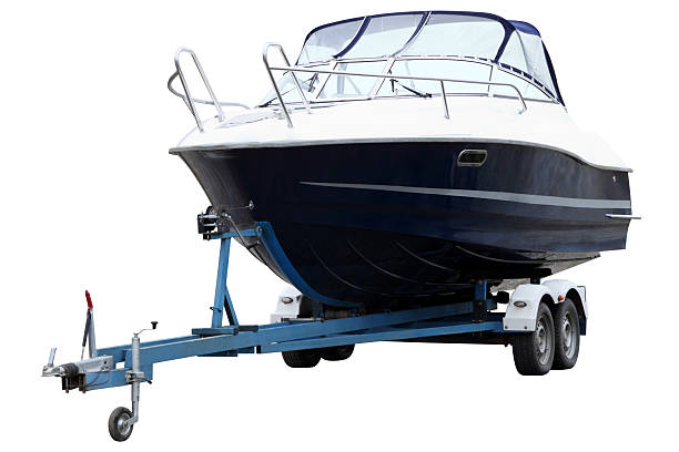 Modern boat. Modern boat loaded on a biaxial trailer. vehicle trailer stock pictures, royalty-free photos & images