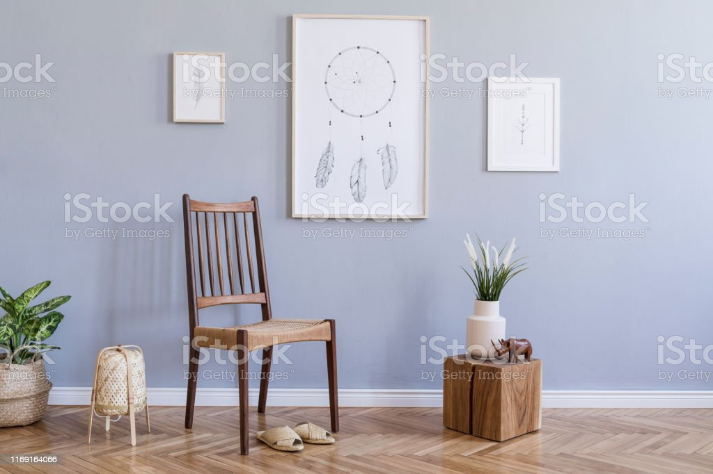 Modern Bohemian Interior Design Of Living Room With Retro Chair Rattan Lamp Wooden Cube Plants Flowers Mock Up Poster Frames And Elegant Accessories Stylish Home Decor Template Gray Walls Stock Photo