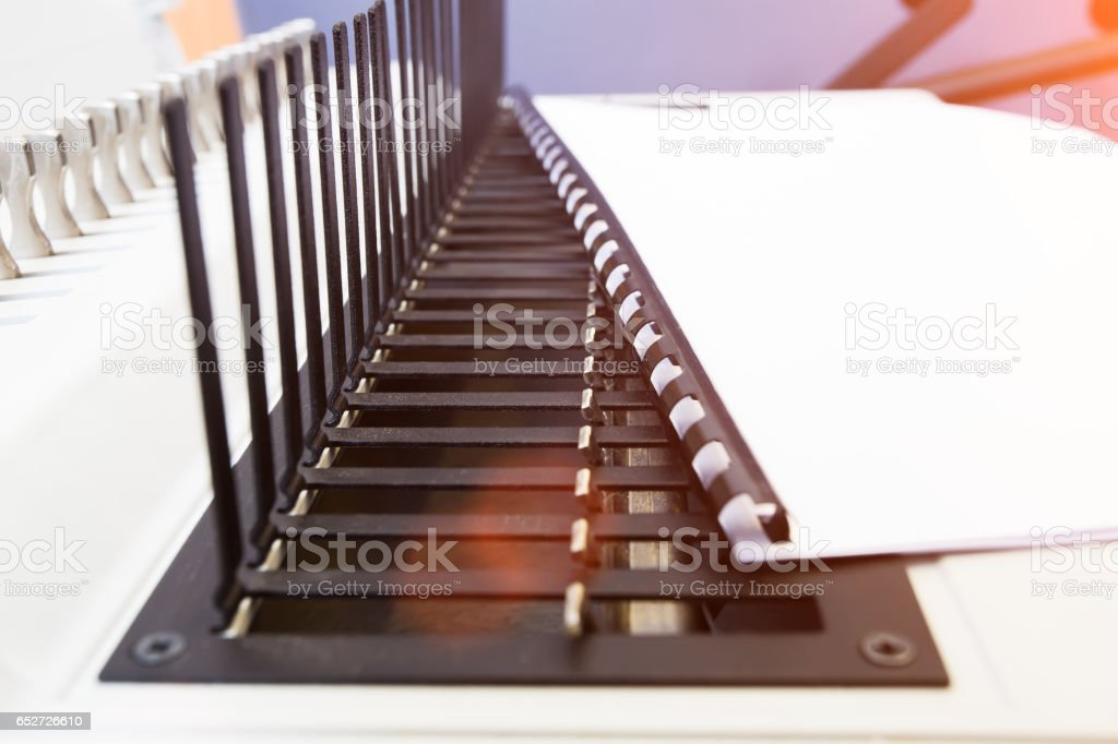 Modern bookbinder in office stock photo