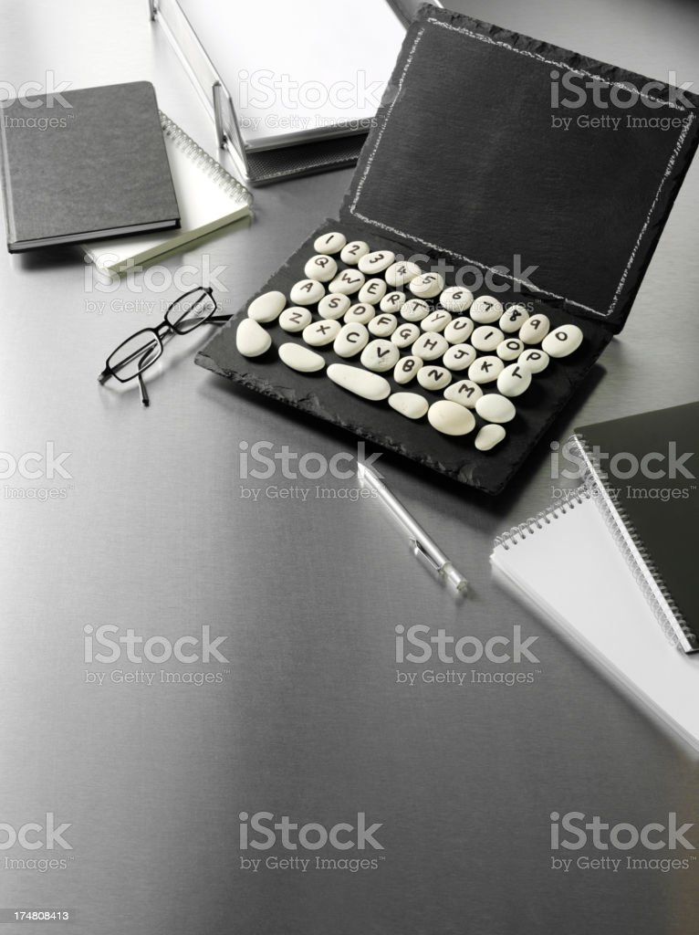 Modern Books and Stationery with  Prehistoric Laptop Computer stock photo