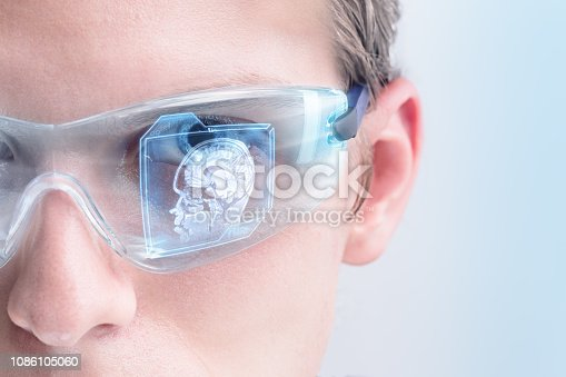 Doctor analyzing brain scan in futuristic augmented reality goggles