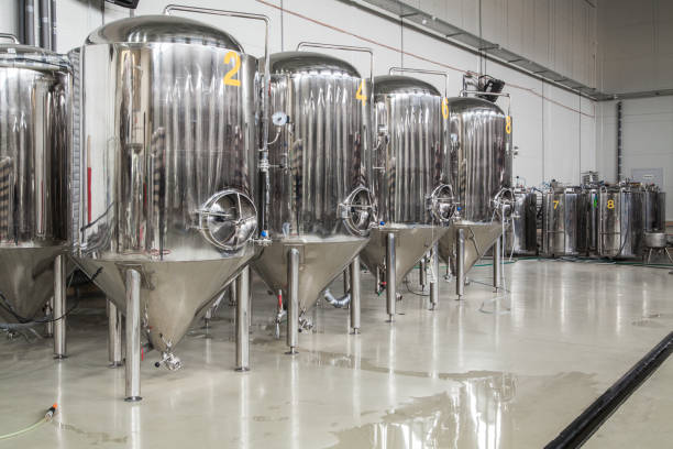 modern brewery with stainless steel tanks - brewery tanks stock pictures, royalty-free photos & images