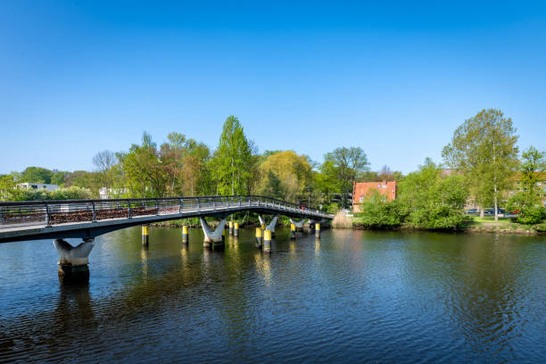 Modern bridge over the River Trave in Lubeck, Germany stock photo