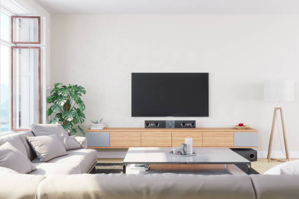modern, bright and airy living room - fernseher and der wand stock-fotos und bilder