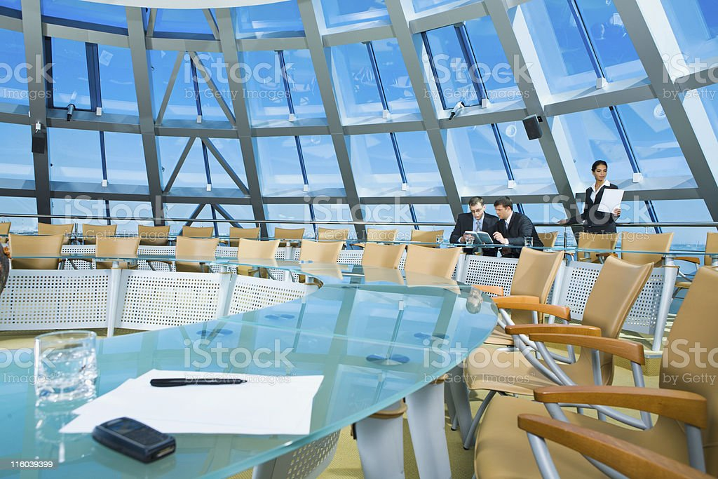 A modern bright glass conference room stock photo