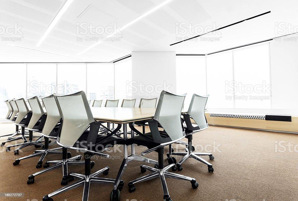 Modern, brightly lit boardroom royalty-free stock photo