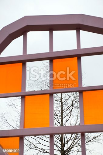 istock modern buildin and leafless branch 689654922