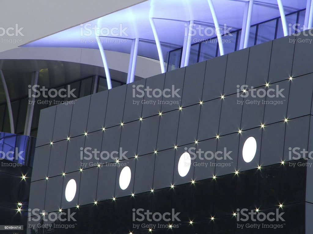 Modern Building - Blue lights and cloudy sky royalty-free stock photo