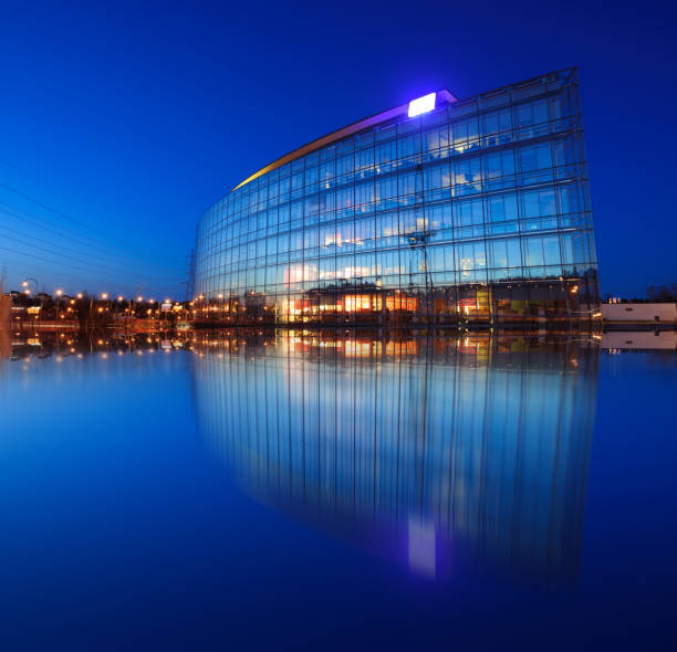 Modern building, blue sky and sunset, reflection stock photo