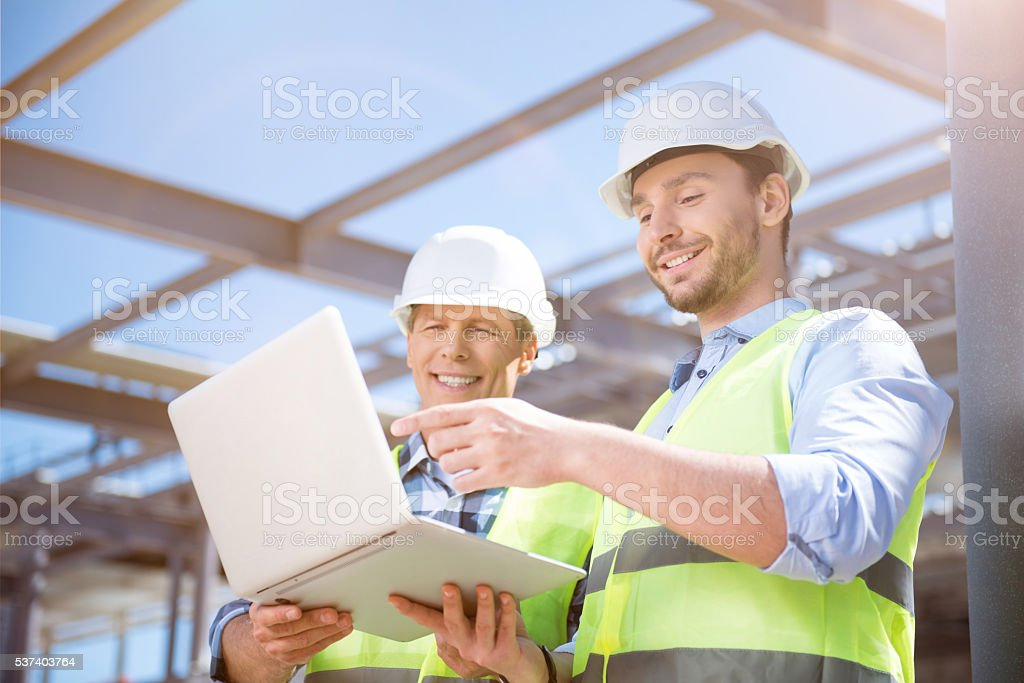 Modern building business and workers stock photo