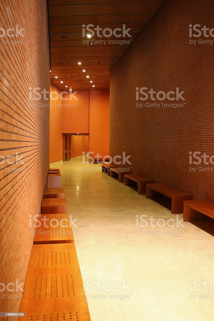 Modern building corridor with brick walls and white floor royalty-free stock photo