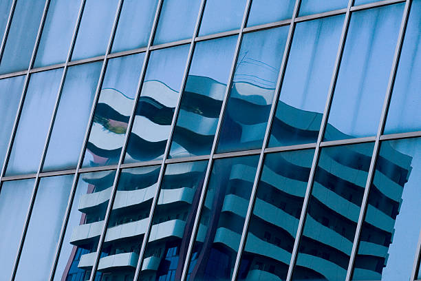 Modern building reflected in the glass windows stock photo